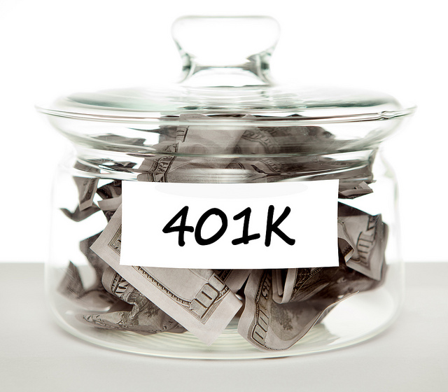 401k jar with one hundred bills inside